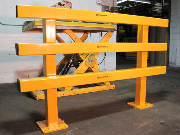 Build-A-Rail Application Photo with protection in front of a scissor lift. Build-A-Rail is a great way to section off and protect machines and other sensitive equipment.