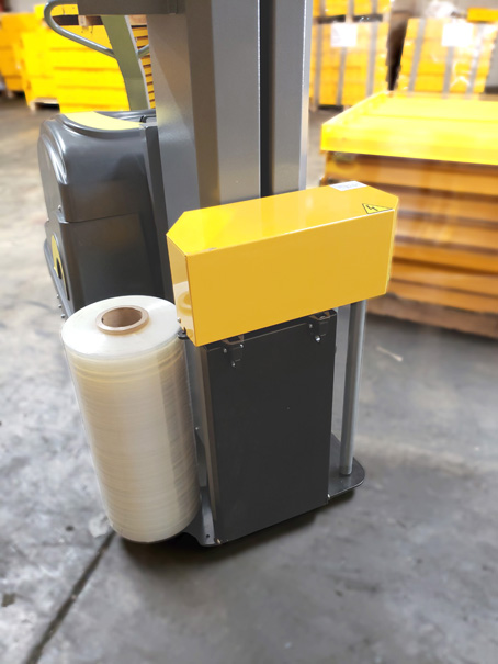 Model 3000 robotic stretch wrap machine with roll of shrink wrap
