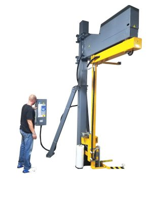 A warehouse operator using the Model 2200 rotating shrink wrap machine